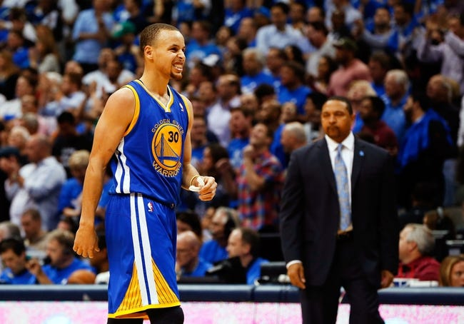 Apr 1, 2014; Dallas, TX, USA; Golden State Warriors guard Stephen Curry (30) reacts during the game against the Dallas Mavericks at American Airlines Center. Golden State won 122-120. Mandatory Credit: Kevin Jairaj-USA TODAY Sports