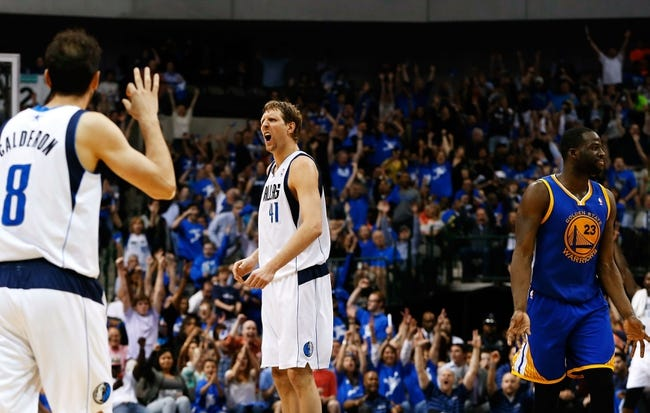 Apr 1, 2014; Dallas, TX, USA; Dallas Mavericks forward Dirk Nowitzki (41) and Golden State Warriors forward Draymond Green (23) react after a Dallas score during the game at American Airlines Center. Golden State won 122-120. Mandatory Credit: Kevin Jairaj-USA TODAY Sports