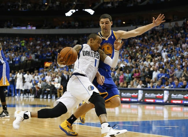 Apr 1, 2014; Dallas, TX, USA; Dallas Mavericks guard Monta Ellis (11) drives to the basket around Golden State Warriors guard Klay Thompson (11) during the game at American Airlines Center. Golden State won 122-120. Mandatory Credit: Kevin Jairaj-USA TODAY Sports