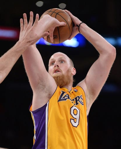 Apr 1, 2014; Los Angeles, CA, USA;  Los Angeles Lakers center Chris Kaman (9) during the second half of the game against the Portland Trail Blazers at Staples Center. Trail Blazers won 124-112. Mandatory Credit: Jayne Kamin-Oncea-USA TODAY Sports