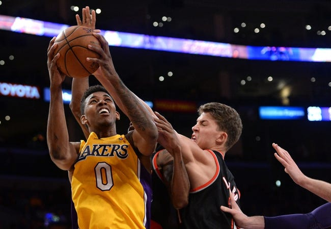 Apr 1, 2014; Los Angeles, CA, USA;  Portland Trail Blazers center Meyers Leonard (11) guards Los Angeles Lakers forward Nick Young (0) during the second half of the game at Staples Center. Trail Blazers won 124-112. Mandatory Credit: Jayne Kamin-Oncea-USA TODAY Sports