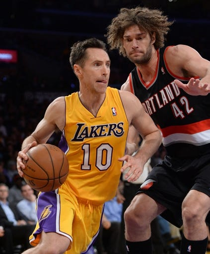 Apr 1, 2014; Los Angeles, CA, USA;  Portland Trail Blazers center Robin Lopez (42) guards Los Angeles Lakers guard Steve Nash (10) during the second half of the game at Staples Center. Trail Blazers won 124-112. Mandatory Credit: Jayne Kamin-Oncea-USA TODAY Sports