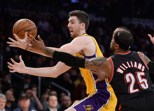 Apr 1, 2014; Los Angeles, CA, USA;  Portland Trail Blazers guard Mo Williams (25) guards Los Angeles Lakers forward Ryan Kelly (4) during the second half of the game at Staples Center. Trail Blazers won 124-112. Mandatory Credit: Jayne Kamin-Oncea-USA TODAY Sports