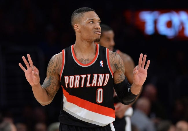 Apr 1, 2014; Los Angeles, CA, USA;  Portland Trail Blazers guard Damian Lillard (0) heads down court after a 3 point basket during the second half of the game against the Los Angeles Lakers at Staples Center. Trail Blazers won 124-112. Mandatory Credit: Jayne Kamin-Oncea-USA TODAY Sports