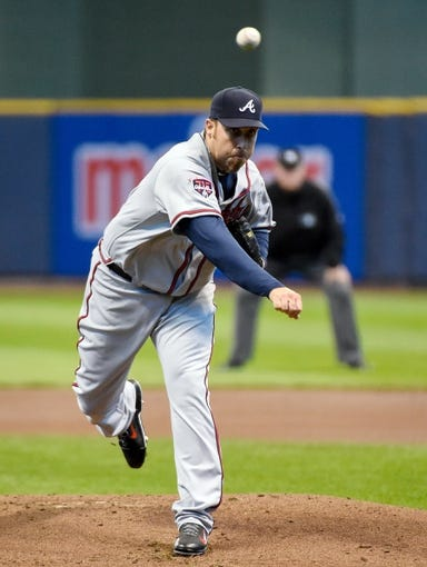 Apr 2, 2014; Milwaukee, WI, USA;  Atlanta Braves pitcher Aaron Harang (34) pitches against the Milwaukee Brewers in the first inning at Miller Park. Mandatory Credit: Benny Sieu-USA TODAY Sports