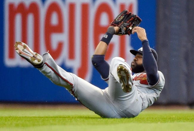 Apr 2, 2014; Milwaukee, WI, USA;  Atlanta Braves right fielder Jason Heyward (22) makes a sliding catch of a ball hit by Milwaukee Brewers right fielder Ryan Braun (not pictured) in the fourth inning at Miller Park. Mandatory Credit: Benny Sieu-USA TODAY Sports