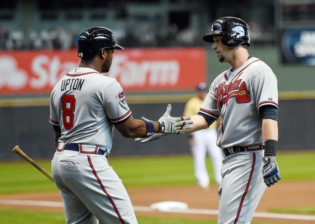Apr 2, 2014; Milwaukee, WI, USA;  Atlanta Braves left fielder Justin Upton (8) greets third baseman Chris Johnson (23) after Johnson hit a home run in the seventh inning against the Milwaukee Brewers at Miller Park. Mandatory Credit: Benny Sieu-USA TODAY Sports