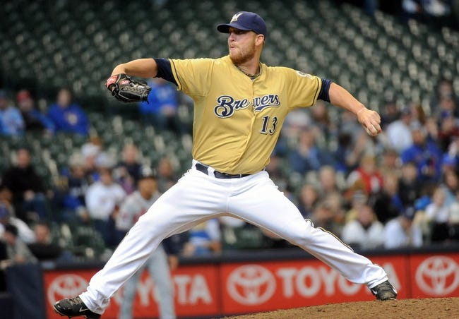 Apr 2, 2014; Milwaukee, WI, USA;  Milwaukee Brewers pitcher Will Smith (13) pitches in the ninth inning against the Atlanta Braves at Miller Park. Mandatory Credit: Benny Sieu-USA TODAY Sports