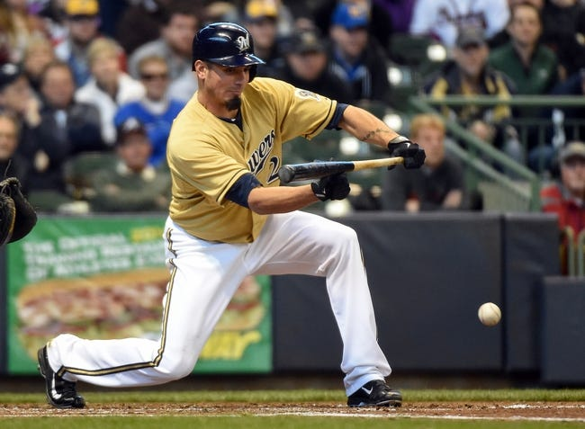 Apr 2, 2014; Milwaukee, WI, USA;   Milwaukee Brewers pitcher Matt Garza (22) puts down a sacrifice bunt in the third inning during the game against the Atlanta Braves at Miller Park. Mandatory Credit: Benny Sieu-USA TODAY Sports