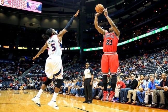 Apr 2, 2014; Atlanta, GA, USA; Chicago Bulls guard Jimmy Butler (21) shoots a three over Atlanta Hawks forward DeMarre Carroll (5) in the first half at Philips Arena. Mandatory Credit: Daniel Shirey-USA TODAY Sports