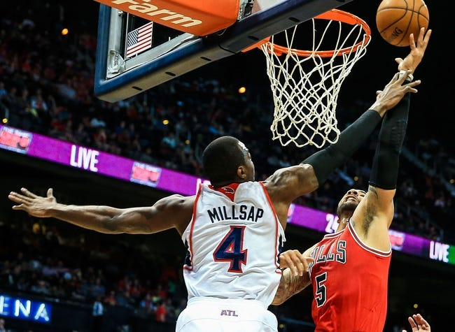 Apr 2, 2014; Atlanta, GA, USA; Chicago Bulls forward Carlos Boozer (5) shoots a basket over Atlanta Hawks forward Paul Millsap (4) in the first half at Philips Arena. Mandatory Credit: Daniel Shirey-USA TODAY Sports