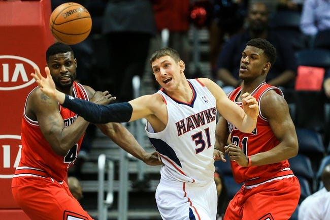 Apr 2, 2014; Atlanta, GA, USA; Atlanta Hawks center Mike Muscala (31) reaches for a loose ball between Chicago Bulls center Nazr Mohammed (48) and guard Jimmy Butler (21) in the first half at Philips Arena. Mandatory Credit: Daniel Shirey-USA TODAY Sports