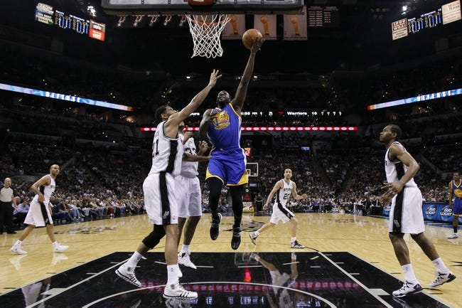 Apr 2, 2014; San Antonio, TX, USA; Golden State Warriors forward Draymond Green (23) shoots as San Antonio Spurs forward Tim Duncan (21) defends during the first half at AT&T Center. Mandatory Credit: Soobum Im-USA TODAY Sports