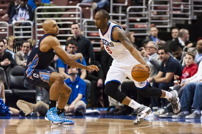 Apr 2, 2014; Philadelphia, PA, USA; Philadelphia 76ers guard James Anderson (9) is defended by Charlotte Bobcats guard Gerald Henderson (9) during the third quarter at the Wells Fargo Center. The Bobcats defeated the Sixers 123-93. Mandatory Credit: Howard Smith-USA TODAY Sports