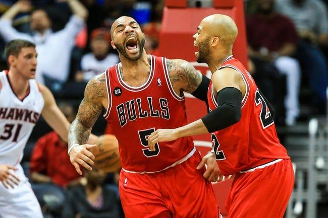 Apr 2, 2014; Atlanta, GA, USA; Chicago Bulls forward Carlos Boozer (5) celebrates a dunk with Chicago Bulls forward Taj Gibson (22) in the second half at Philips Arena. The Bulls won 105-92. Mandatory Credit: Daniel Shirey-USA TODAY Sports