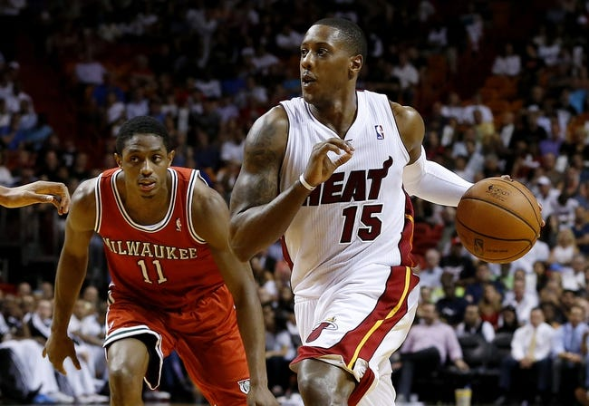 Apr 2, 2014; Miami, FL, USA; Miami Heat guard Mario Chalmers (15) dribbles the ball past Milwaukee Bucks guard Brandon Knight (11)   in the second half at American Airlines Arena. The Heat won 96-77.  Mandatory Credit: Robert Mayer-USA TODAY Sports