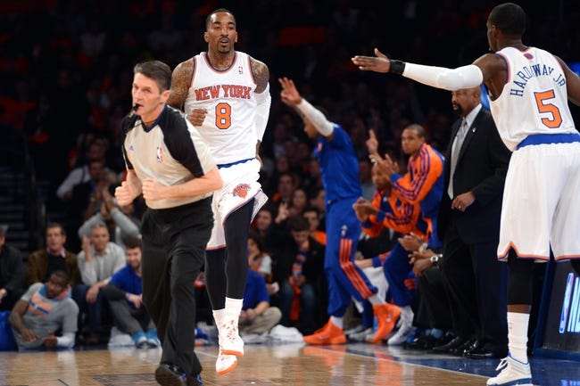 Apr 2, 2014; New York, NY, USA; New York Knicks guard J.R. Smith (8) reacts after a basket against the Brooklyn Nets during the first half at Madison Square Garden. The New York Knicks won 110-81. Mandatory Credit: Joe Camporeale-USA TODAY Sports