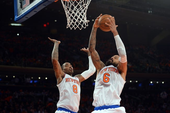 Apr 2, 2014; New York, NY, USA; New York Knicks center Tyson Chandler (6) pulls down a rebound over New York Knicks guard J.R. Smith (8) during the first half at Madison Square Garden. The New York Knicks won 110-81. Mandatory Credit: Joe Camporeale-USA TODAY Sports