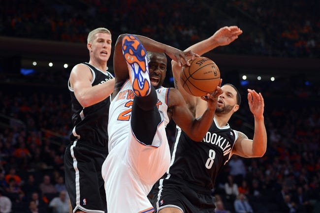 Apr 2, 2014; New York, NY, USA; New York Knicks guard Raymond Felton (2) pulls down a rebound against the Brooklyn Nets during the second half at Madison Square Garden. The New York Knicks won 110-81. Mandatory Credit: Joe Camporeale-USA TODAY Sports