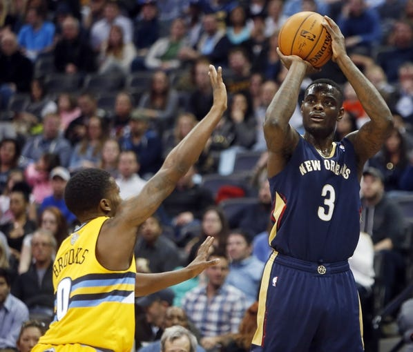 Apr 2, 2014; Denver, CO, USA; New Orleans Pelicans guard Anytony Morrow (3) shoots the ball during the first half against the Denver Nuggets at Pepsi Center. Mandatory Credit: Chris Humphreys-USA TODAY Sports