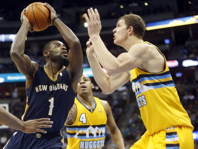 Apr 2, 2014; Denver, CO, USA; New Orleans Pelicans guard Tyreke Evans (1) drives to the basket during the first half against the Denver Nuggets at Pepsi Center. Mandatory Credit: Chris Humphreys-USA TODAY Sports