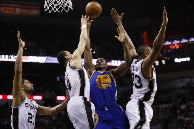 Apr 2, 2014; San Antonio, TX, USA; Golden State Warriors forward Harrison Barnes (40) shoots as San Antonio Spurs forward Jeff Ayres (11) and Boris Diaw (33) defend during the second half at AT&T Center. The Spurs won 111-90. Mandatory Credit: Soobum Im-USA TODAY Sports