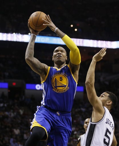 Apr 2, 2014; San Antonio, TX, USA; Golden State Warriors forward Marreese Speights (5) shoots as San Antonio Spurs guard Cory Joseph (5) defends during the second half at AT&T Center. The Spurs won 111-90. Mandatory Credit: Soobum Im-USA TODAY Sports
