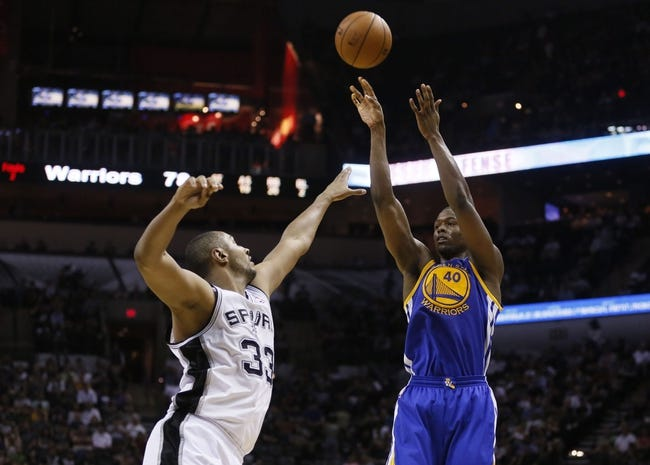 Apr 2, 2014; San Antonio, TX, USA; Golden State Warriors forward Harrison Barnes (40) shoots the ball over San Antonio Spurs forward Boris Diaw (33) during the second half at AT&T Center. The Spurs won 111-90. Mandatory Credit: Soobum Im-USA TODAY Sports