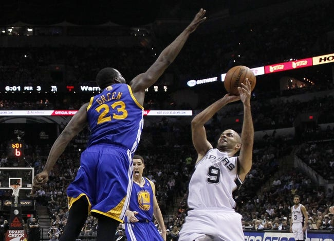 Apr 2, 2014; San Antonio, TX, USA; San Antonio Spurs guard Tony Parker (9) shoots the ball over Golden State Warriors forward Draymond Green (23) during the second half at AT&T Center. The Spurs won 111-90. Mandatory Credit: Soobum Im-USA TODAY Sports