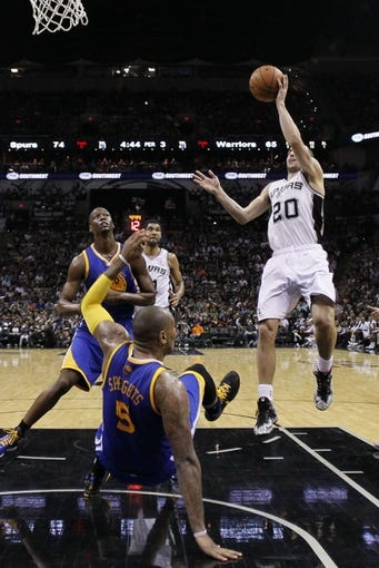 Apr 2, 2014; San Antonio, TX, USA; San Antonio Spurs guard Manu Ginobili (20) shoots the ball against the Golden State Warriors during the second half at AT&T Center. The Spurs won 111-90. Mandatory Credit: Soobum Im-USA TODAY Sports