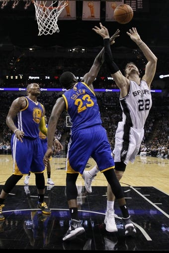 Apr 2, 2014; San Antonio, TX, USA; San Antonio Spurs forward Tiago Splitter (22) has his shot blocked by Golden State Warriors forward Draymond Green (23) during the second half at AT&T Center. The Spurs won 111-90. Mandatory Credit: Soobum Im-USA TODAY Sports