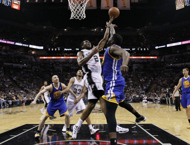 Apr 2, 2014; San Antonio, TX, USA; San Antonio Spurs forward Kawhi Leonard (2) shoots the ball as Golden State Warriors forward Draymond Green (front) defends during the second half at AT&T Center. The Spurs won 111-90. Mandatory Credit: Soobum Im-USA TODAY Sports