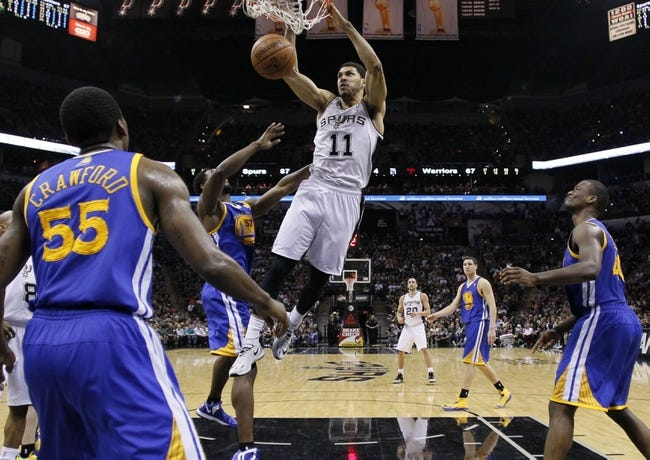 Apr 2, 2014; San Antonio, TX, USA; San Antonio Spurs forward Jeff Ayres (11) dunks the ball against the Golden State Warriors during the second half at AT&T Center. The Spurs won 111-90. Mandatory Credit: Soobum Im-USA TODAY Sports