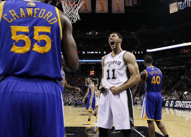 Apr 2, 2014; San Antonio, TX, USA; San Antonio Spurs forward Jeff Ayres (11) reacts after a dunk against the Golden State Warriors during the second half at AT&T Center. The Spurs won 111-90. Mandatory Credit: Soobum Im-USA TODAY Sports