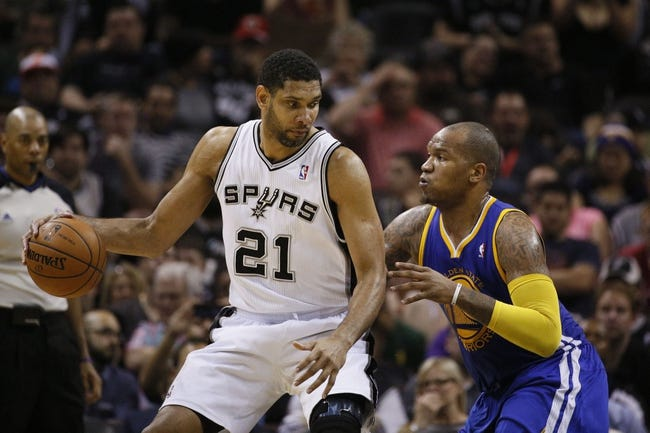 Apr 2, 2014; San Antonio, TX, USA; San Antonio Spurs forward Tim Duncan (21) posts up against Golden State Warriors forward Marreese Speights (right) during the second half at AT&T Center. The Spurs won 111-90. Mandatory Credit: Soobum Im-USA TODAY Sports