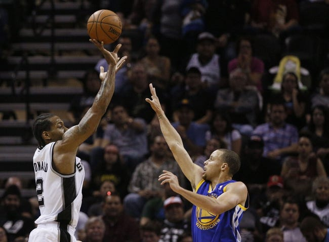 Apr 2, 2014; San Antonio, TX, USA; San Antonio Spurs forward Kawhi Leonard (2) shoots the ball over Golden State Warriors guard Stephen Curry (right) during the second half at AT&T Center. The Spurs won 111-90. Mandatory Credit: Soobum Im-USA TODAY Sports
