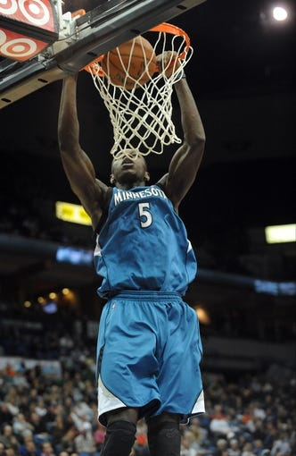 Apr 2, 2014; Minneapolis, MN, USA;  Minnesota Timberwolves center Gorgui Dieng (5) dunks in the third quarter against the Memphis Grizzlies at Target Center. The Wolves defeated the Grizzlies 102-88.  Mandatory Credit: Marilyn Indahl-USA TODAY Sports