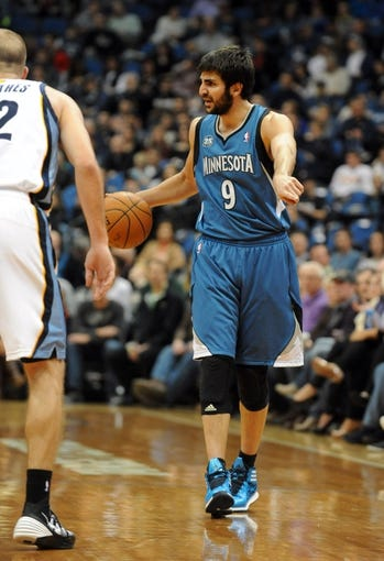 Apr 2, 2014; Minneapolis, MN, USA;  Minnesota Timberwolves guard Ricky Rubio (9) calls the play in the third quarter against the Memphis Grizzlies at Target Center. The Wolves defeated the Grizzlies 102-88.  Mandatory Credit: Marilyn Indahl-USA TODAY Sports