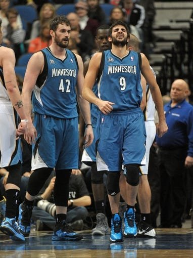Apr 2, 2014; Minneapolis, MN, USA;  Minnesota Timberwolves guard Ricky Rubio (9) favors his left ankle after a play under the net in the third quarter against the Memphis Grizzlies at Target Center. The Wolves defeated the Grizzlies 102-88.  Mandatory Credit: Marilyn Indahl-USA TODAY Sports