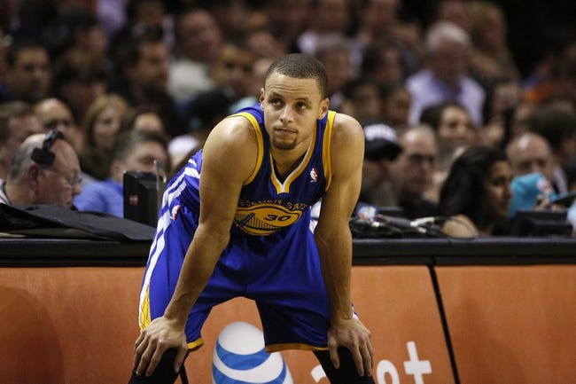 Apr 2, 2014; San Antonio, TX, USA; Golden State Warriors guard Stephen Curry (30) waits to enter the game during the first half against the San Antonio Spurs at AT&T Center. Mandatory Credit: Soobum Im-USA TODAY Sports