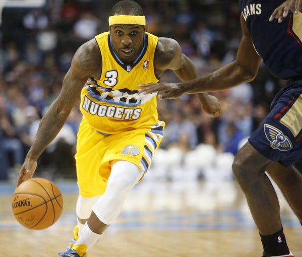 Apr 2, 2014; Denver, CO, USA; Denver Nuggets guard Ty Lawson (3) drives to the basket during the second half against the New Orleans Pelicans at Pepsi Center.  The Nuggets won 137-107.  Mandatory Credit: Chris Humphreys-USA TODAY Sports