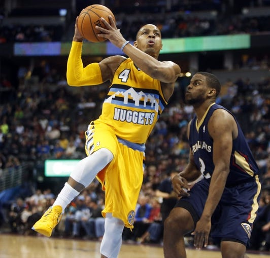 Apr 2, 2014; Denver, CO, USA; Denver Nuggets guard Randy Foye (4) shoots the ball during the second half against the New Orleans Pelicans at Pepsi Center.  The Nuggets won 137-107.  Mandatory Credit: Chris Humphreys-USA TODAY Sports