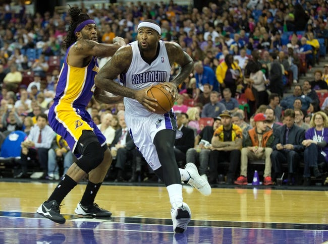 Apr 2, 2014; Sacramento, CA, USA; Sacramento Kings center DeMarcus Cousins (15) drives in against Los Angeles Lakers forward Jordan Hill (27) during the third quarter at Sleep Train Arena. The Sacramento Kings defeated the Los Angeles Lakers 107-102. Mandatory Credit: Kelley L Cox-USA TODAY Sports