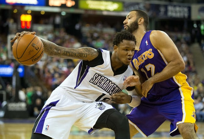 Apr 2, 2014; Sacramento, CA, USA; Sacramento Kings guard Ben McLemore (16) drives in against Los Angeles Lakers guard Kendall Marshall (12) during the fourth quarter at Sleep Train Arena. The Sacramento Kings defeated the Los Angeles Lakers 107-102. Mandatory Credit: Kelley L Cox-USA TODAY Sports