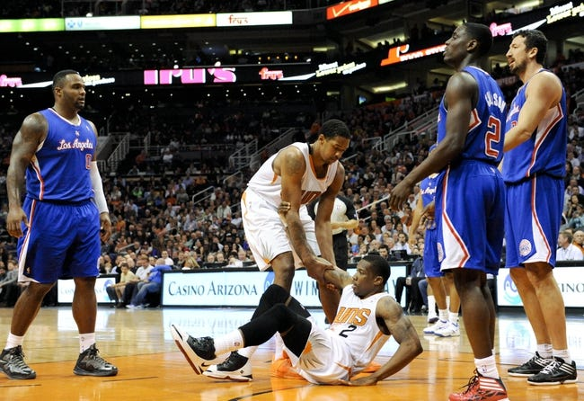 Apr 2, 2014; Phoenix, AZ, USA; Phoenix Suns forward Channing Frye (8) helps up guard Eric Bledsoe (2) during the fourth quarter against the Los Angeles Clippers at US Airways Center. The Clippers won 112-108. Mandatory Credit: Casey Sapio-USA TODAY Sports