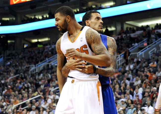 Apr 2, 2014; Phoenix, AZ, USA; Phoenix Suns forward Markieff Morris (11) and Los Angeles Clippers forward Matt Barnes (22) get tangled up during the third quarter at US Airways Center. The Clippers won 112-108. Mandatory Credit: Casey Sapio-USA TODAY Sports