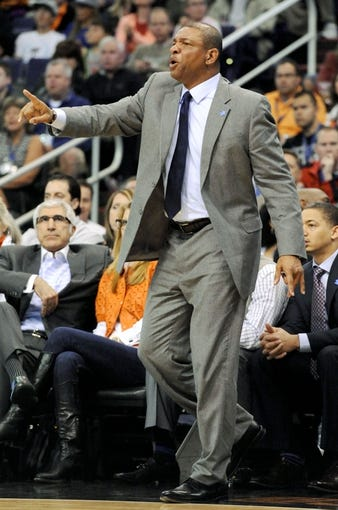 Apr 2, 2014; Phoenix, AZ, USA; Los Angeles Clippers head coach Doc Rivers reacts during the second quarter against the Phoenix Suns at US Airways Center. The Clippers won 112-108. Mandatory Credit: Casey Sapio-USA TODAY Sports