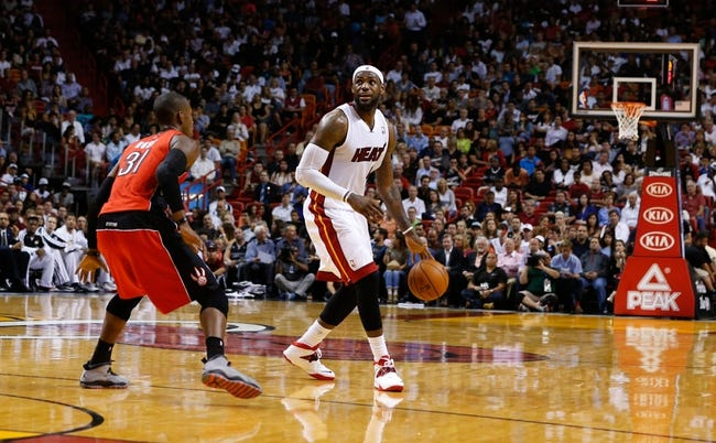 Mar 31, 2014; Miami, FL, USA; Miami Heat forward LeBron James (6) dribbles the ball as Toronto Raptors forward Terrence Ross (31) defends n the second half at American Airlines Arena. Mandatory Credit: Robert Mayer-USA TODAY Sports