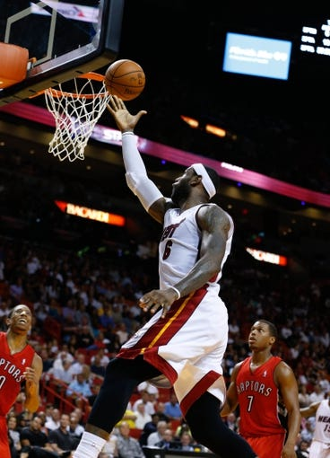 Mar 31, 2014; Miami, FL, USA; Miami Heat forward LeBron James (6) shoots the ball in the second half of a game against the Toronto Raptors at American Airlines Arena. Mandatory Credit: Robert Mayer-USA TODAY Sports