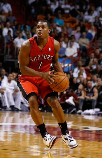 Mar 31, 2014; Miami, FL, USA;  Toronto Raptors guard Kyle Lowry (7) dribbles the ball in the first half of a game against the Miami Heat at American Airlines Arena. Mandatory Credit: Robert Mayer-USA TODAY Sports